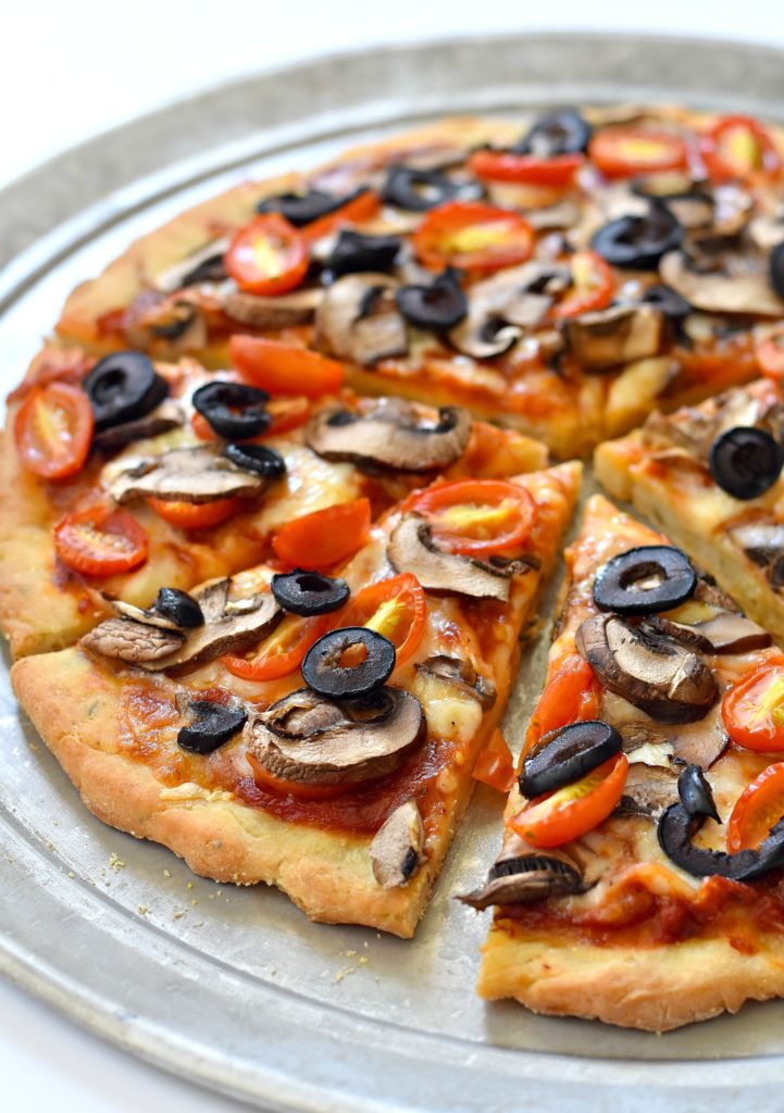This recipe for a gluten free vegan pizza dough makes for the perfect thin crust canvas for your favorite toppings!