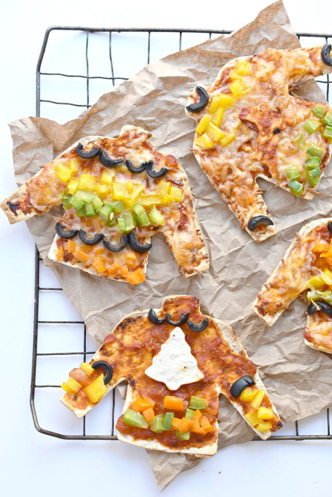 Throw an Ugly Sweater Pizza Party this Christmas using FlatOut's artisan pizza crusts and a sweater cookie cutter!