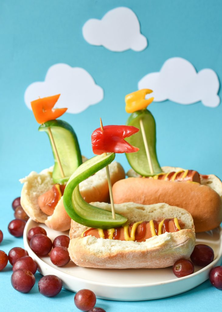 Turn your next summertime lunch for your kiddos into an ocean scene with these Veggie Dog Sailboats!