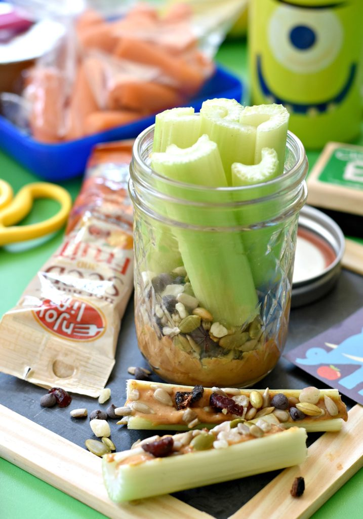 Celery and SunButter in mason jars: With just a few simple tweaks you can turn your kid's lunchbox into a masterpiece with these five Top 8 safe snacks for kids!