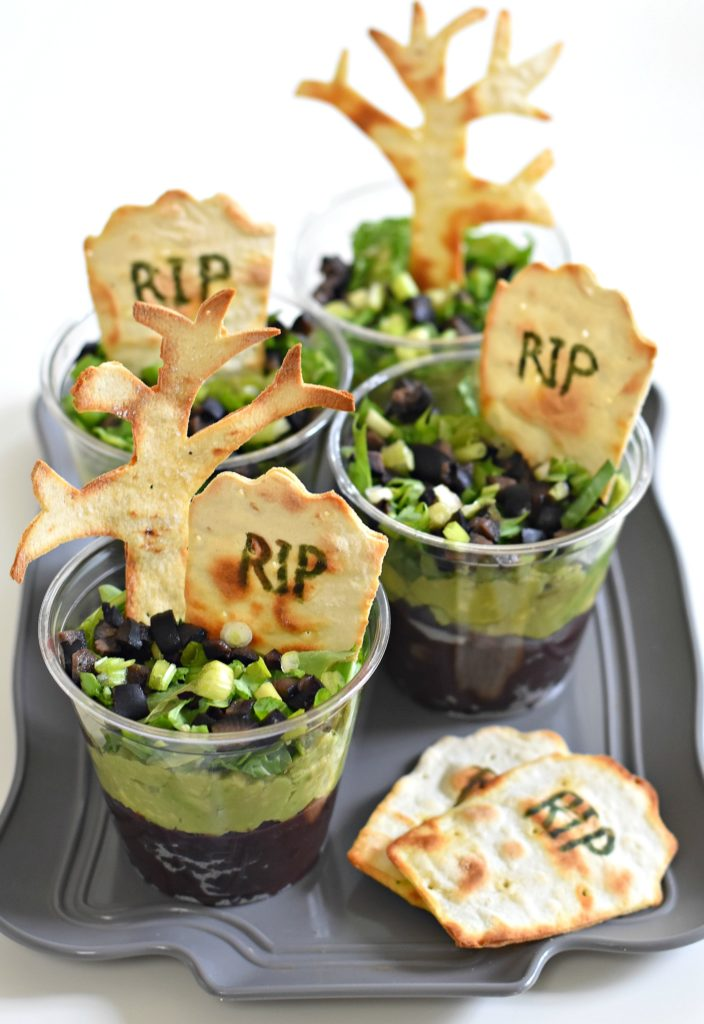Turn dinner into an easy Halloween-themed meal by layering simple ingredients over each other to make them in Graveyard Taco Cups. Careful for ghosts!