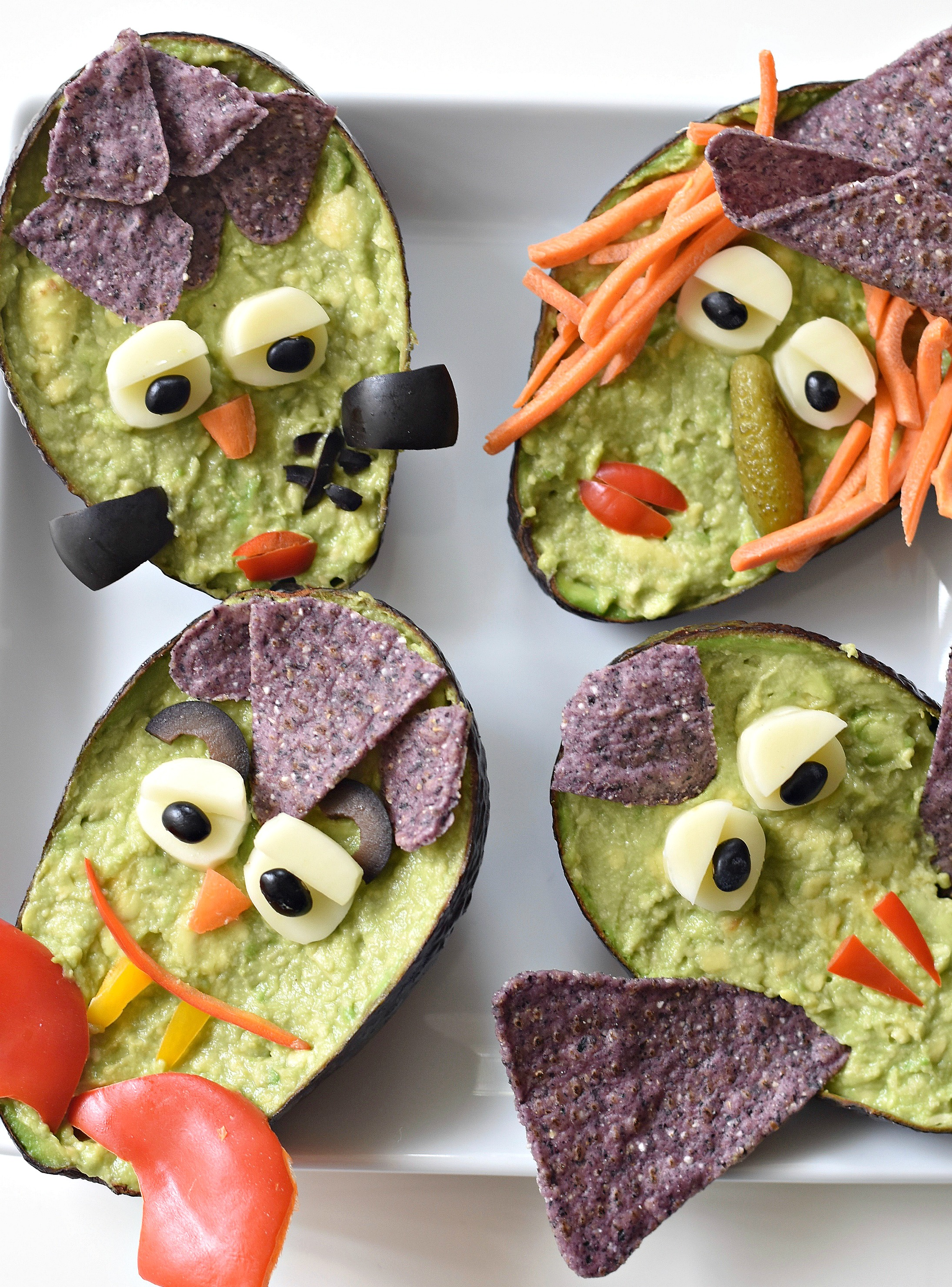 Just scoop out the flesh of the avocado, turn into guacamole, place back into the avocado shell, and make one (or all) of your favorite Halloween GuacaMonsters.